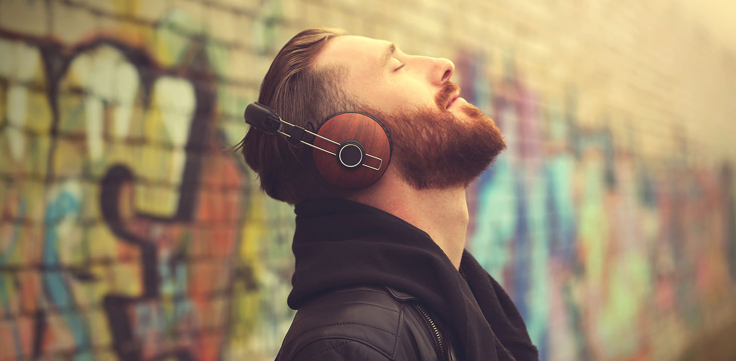 Guy listening to music on his headphones